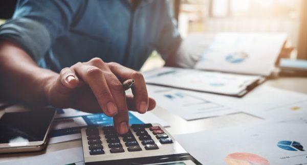 A consumer calculating their finances.