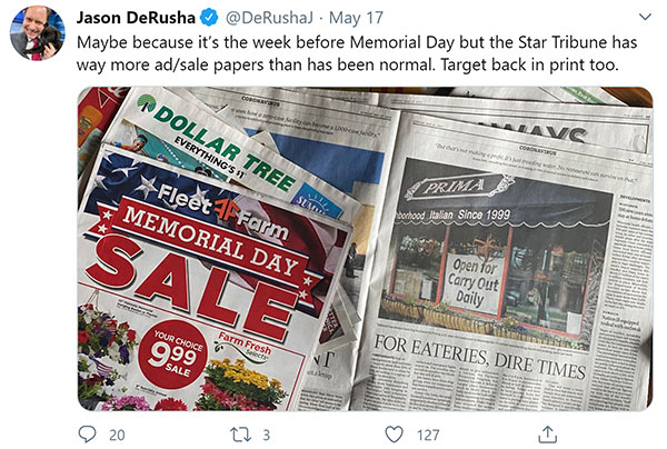 """Screen capture of tweet by Jason DeRusha, """"Maybe because it's the week before Memorial Day but the Star Tribune has way more ad/sale papers than has been normal. Target back in print too. Below text: photograph of print ads from newspaper."""