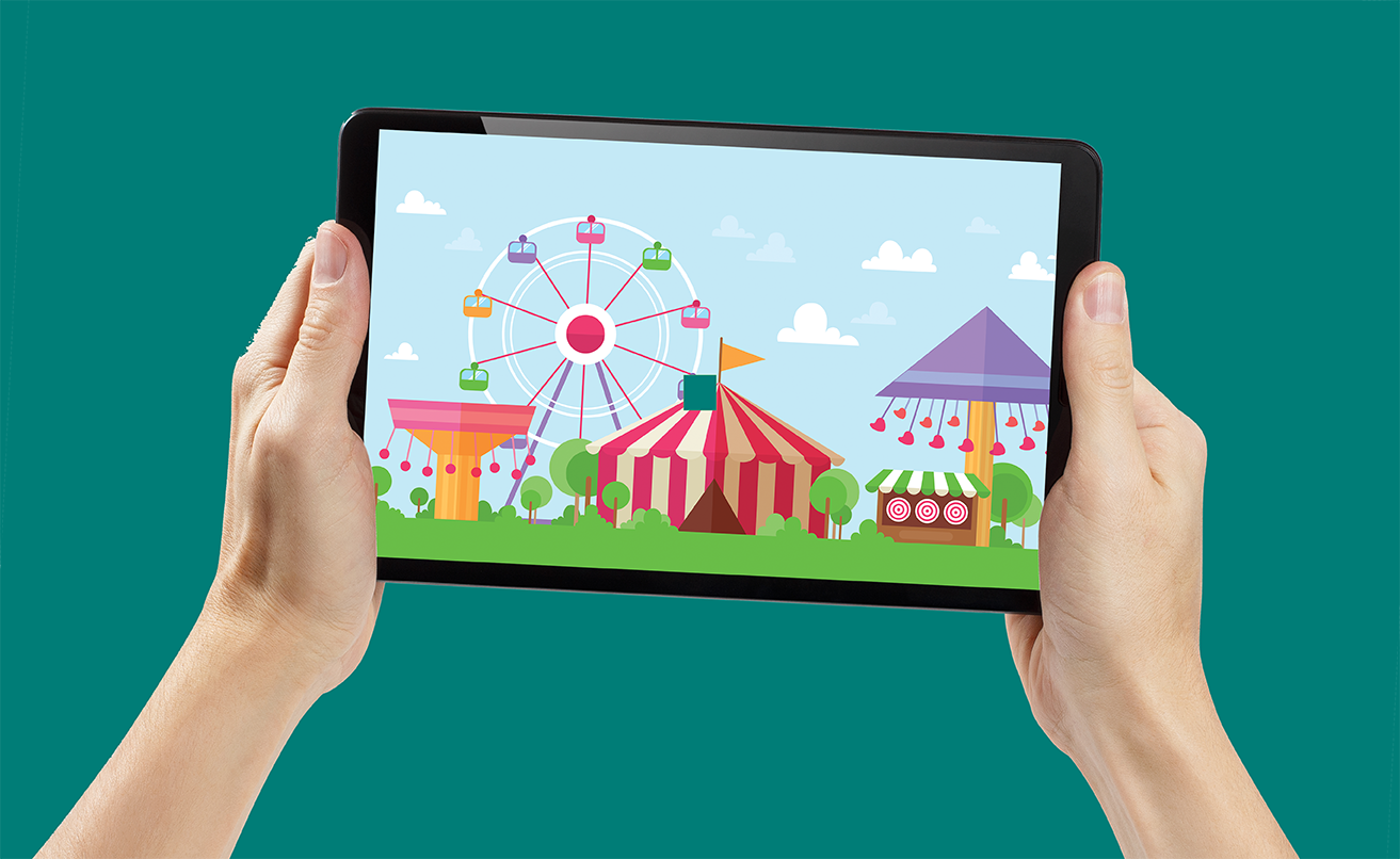 Hands holding a tablet with image of fair on isolated green background